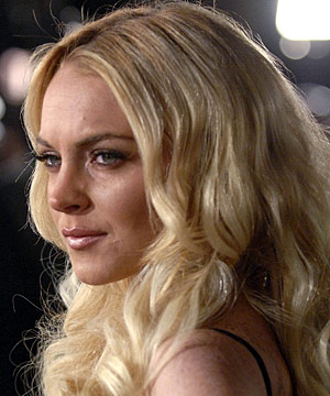 PLAYBOY BUNNY: Hugh Hefner reportedly wants Lindsay Lohan to pose nude as ...