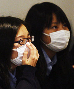 PROTECTION: Japanese pupils wearing flu masks wait for checkups at the High Street Medical Centre in Christchurch yesterday.