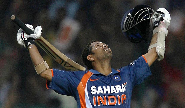 India's Sachin Tendulkar looks skyward after becoming the first player score an ODI double century.