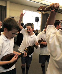 Craig Smith, 12, centre, rocks his ukulele