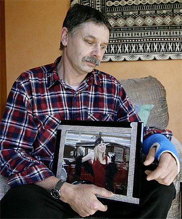 PAIN UNENDING: Michael Macready holds a picture of his daughter Rhya Macready, who  died in the car accident that nearly killed him too.