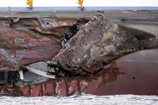 A view of one of the two leaks in the capsized Costa Concordia cruise ship after being holed by a rock off the west coast of Italy, at Giglio island.