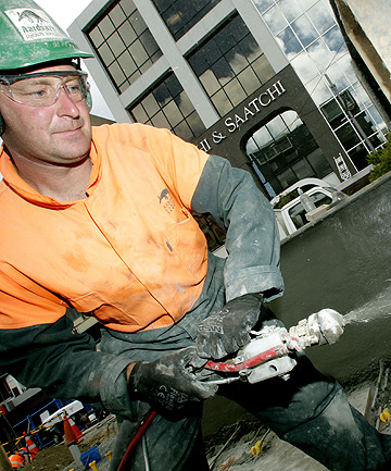 BOOSTER: Peter Jones, of Aardvark Concrete Services, sprays Flexus, a flexible concrete used to earthquake-strengthen buildings.