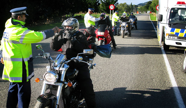 Police stop Motorcyclists