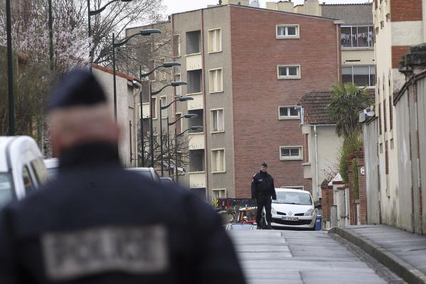 French police block a street during the standoff in Toulouse with a gunman who admitted shooting dead seven people.