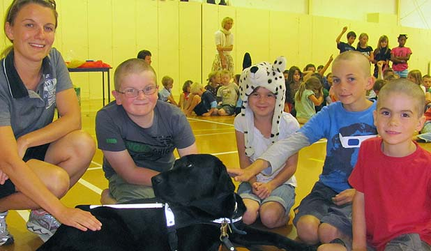 Springbank school students with guide dog