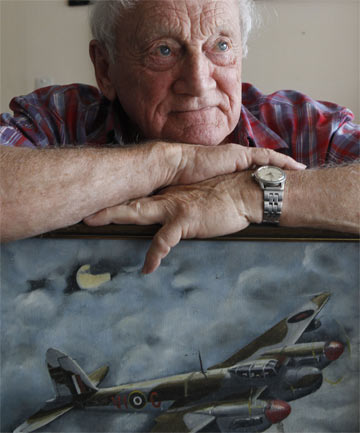 'MOSSIE' PILOT: John Beeching of Nelson with a painting of one of the RAF Mosquito bombers he flew during World War II.