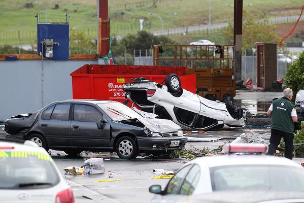 Damaged cars in the carpark of the Albany Mega Centre where a tornado struck this afternoon.
