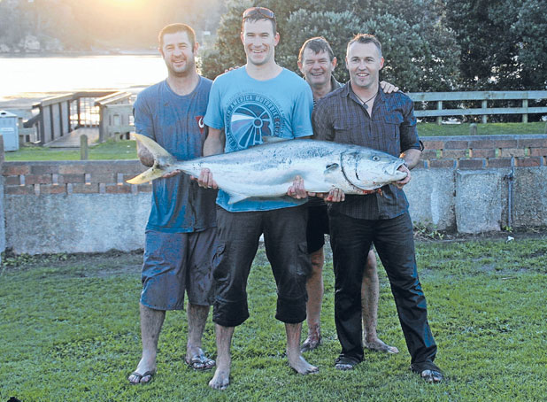 BIG CATCH: The fish herders, from left, Richard Hart, Steve Darby, David Darby and Dan Mills are drenched yet stoked with their catch.
