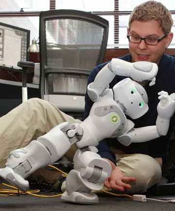 Christoph Bartneck says people respond to intelligent robots as if they are alive. 
