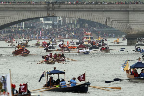 Boats line up for the start of the jubilee river pageant in London.
