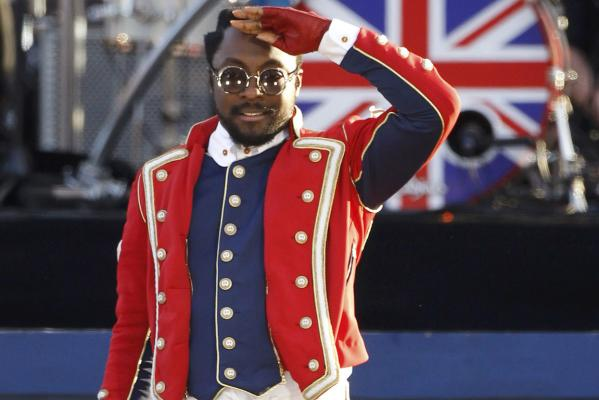 US musician will.i.am salutes the crowd as he performs during the Diamond Jubilee concert in front of Buckingham Palace in London.