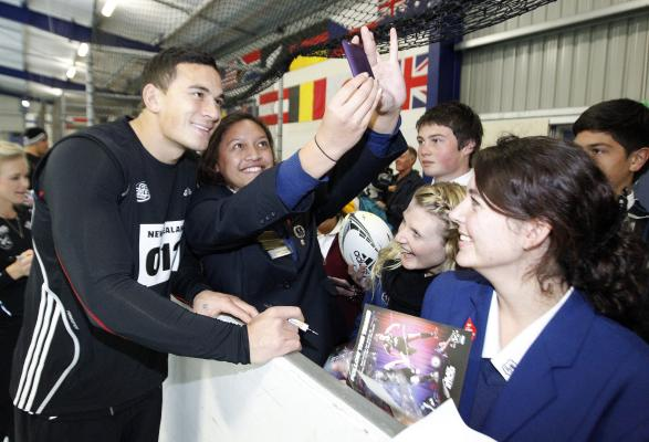 FAN FAVOURITE: Sonny Bill Williams signs autographs and poses for photos with young fans.