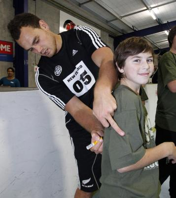 STAR BACK: Israel Dagg signs a young fan's shirt.