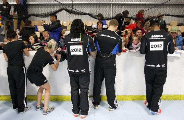 FAN ZONE:  Black Sticks and All Blacks sign autographs for fans.