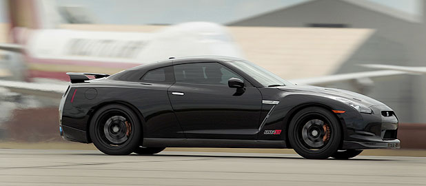 An Alpha 12 Nissan GT-R from AMS Performance, originally a Nissan GT-R, is driven on the runway of the Oscoda-Wurtsmith Airport in Oscoda.