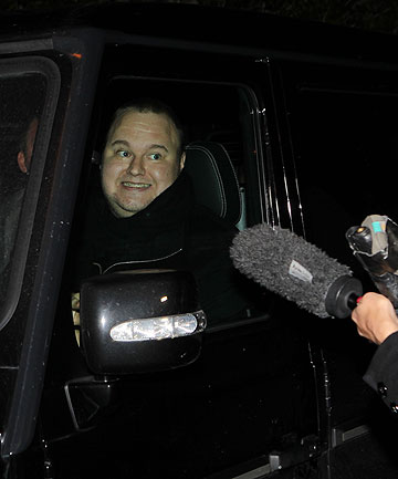 RISK OF EXTRADITION REMAINS: Kim Dotcom outside the Coatesville Settlers Hall. He entered through a back door and would not speak to reporters.