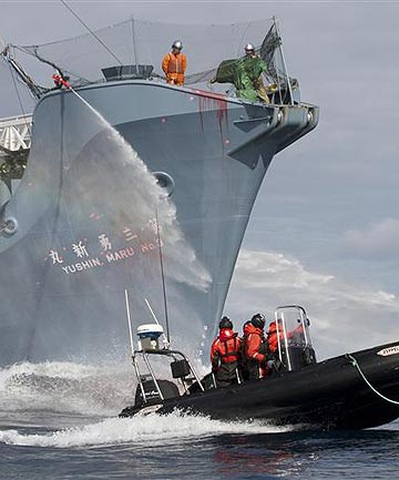 Japanese whaling fleet vessel Yushin Maru No. 3 sprays water cannons at Sea Shepherd activists in a dinghy boat during a clashes in the Southern Ocean in 2011.