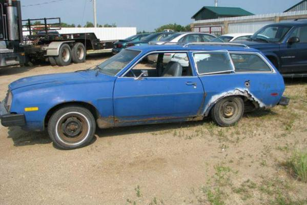 A unsafe Ford Pinto car stopped by police while driving on a US highway.
