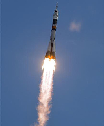 A Soyuz spacecraft carrying the International Space Station crew of Russian cosmonaut Yuri Malenchenko, Japanese astronaut Akihiko Hoshide and US astronaut Sunita Williams blasts off from its launch pad at the Baikonur cosmodrome.