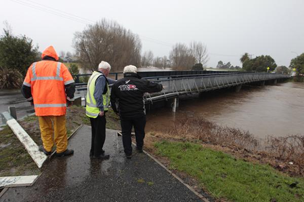 Staff assessing the Criterion Bridge into Paeroa on SH26 which has been closed because of the danger of flooding.