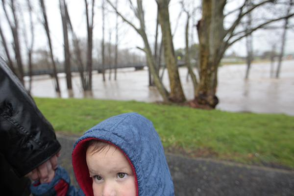 Joanna Fictoor takes her son Robson Nielsen, 2, to see why he cannot walk under the bridge in Paeroa today.