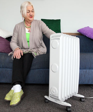 Barbara Joyce, 73, is thrilled to have a new heater to warm her earthquake-damaged Aranui home this winter.