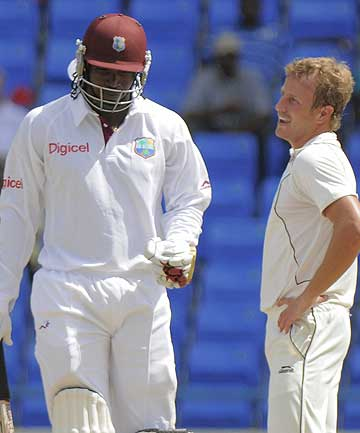 New Zealand's Neil Wagner chats with Windies batting star Chris Gayle during day two of the first test at Sir Vivian Richards Stadium, Antigua.