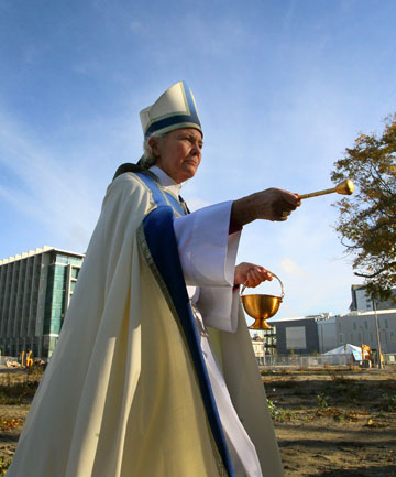 Bishop Victoria Matthews blesses the site where the temporary Christ Church Cathedral will sit on the corner of Hereford and Madras streets overlooking Latimer Square.