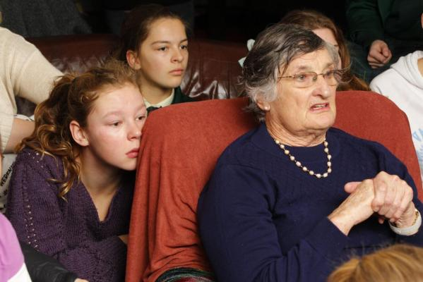 Nick Willis' sister, Ruby, 15 (left), sits alongside neighbour Judith Forster as they watch Nick Willis run in the final of the men's 1500m at the London Olympics.