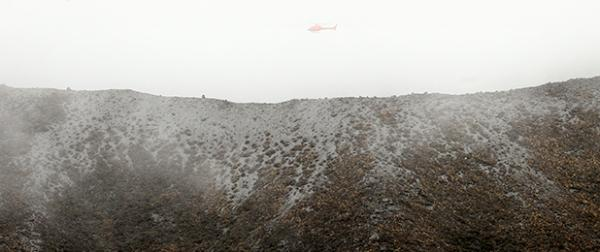 The weather has closed in around Te Maari crater again today as helicopters ferry DOC officials and scientists around the crater to get a better view.