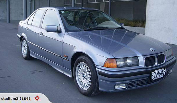 SNAPPED UP: The 1994 blue BMW 320i was erroneously listed on Trade Me with a buy now price of $1 by Christchurch  car dealership Stadium Cars.