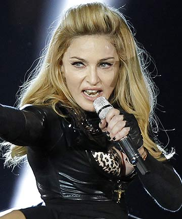 Madonna performs during a concert for her MDNA world tour at the Stade de France Stadium in Saint-Denis, near Paris.