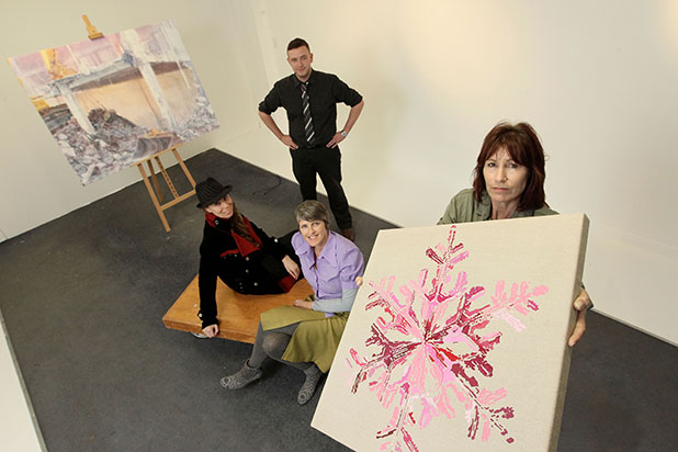 CREATIVE FLAIR: From left: Lisa Benson, Deborah Duffield, Craig McClure (standing) and Anne Challinor, the four Hamilton artists who make up collective Draw Inc.