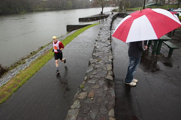 Competitors brave the rain during the 2012 Arthritis New Zealand marathon, half-marathon, 14-kilometre run and 7km run along the Waikato River.
