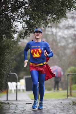 Trent ''Marathon Man'' Morrow battles the rain to run the 2012 Arthritis NZ Marathon in Hamilton.