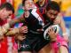 Warriors winger Manu Vatuvei is dragged down by Penrith defenders during their NRL match at Mt Smart Stadium.