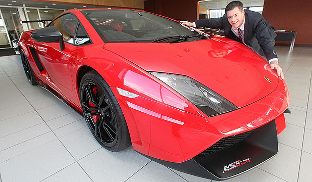 DRIVE ME: Lamborghini Auckland product specialist Mark Wilson with a Lamborghini Gallardo LP 560-4 which some lucky punter could take home.