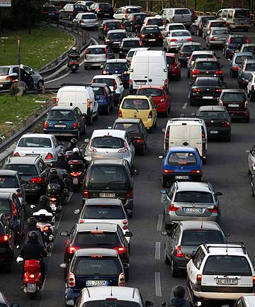 Motorists in Rome not only have to contend with rush-hour traffic congestion but rising gas prices.