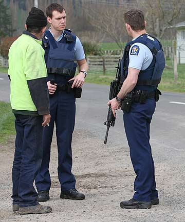 ARMED RESPONSE: Police gather near the scene where a hunter was fatally shot.
