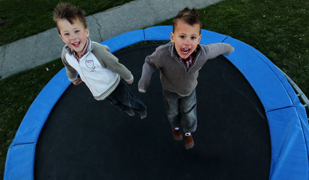 The 4-year-old White twins Cooper, left, and Leo. Mother  Jill says that age is too young to start school.