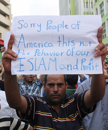 SUPPORTERS RALLY: A demonstrator holds a message during a rally last week to condemn the killers of the US Ambassador to Libya and the attack on the US consulate in Benghazi.