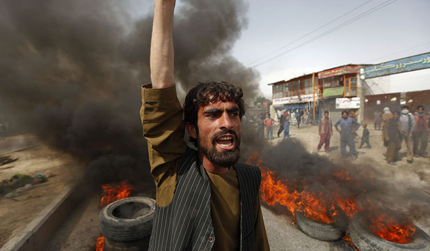 A MATTER OF RELIGION: An Afghan protester shouts slogans during a demonstration in Kabul against a film mocking the Prophet Mohammed. 