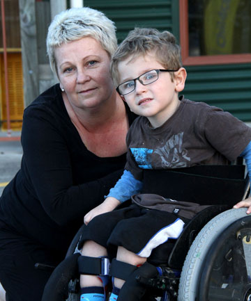 Austin, 4, with mum Helen Manning. Austin's family have fought for four years to have his disability recognised by ACC.