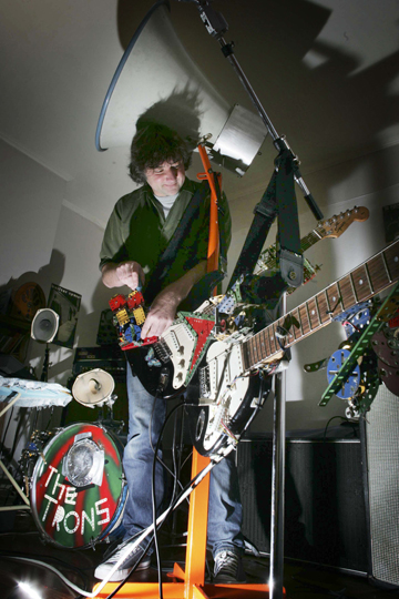 ROBOT REBOOT: Greg Locke tunes up an earlier incarnation of his robot band The Trons.