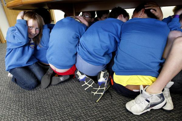 Pupils from Reignier Primary School take part in the ShakeOut drill at the offices of Civil Defence Minister Chris Tremain.