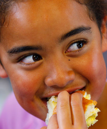 Kaylah Ariu-Woolley, 10, enjoys her free lunch at Cannons Creek School