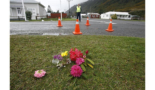 CHILD MOURNED: Flowers have been left close to the site where 5-year-old Mahuri Bettjeman-Manawatu was killed.