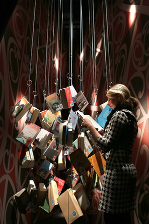 A visitor with the hanging books at the New Zealand stand at the Frankfurt Book Fair in Germany. The fair is the largest in the world and runs from October 10-14