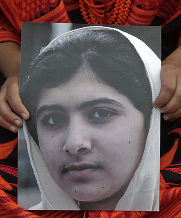 SYMBOL OF RESISTANCE: A student holds an image of Malala Yousufzai, who was shot by the Taliban, during a rally in Lahore.